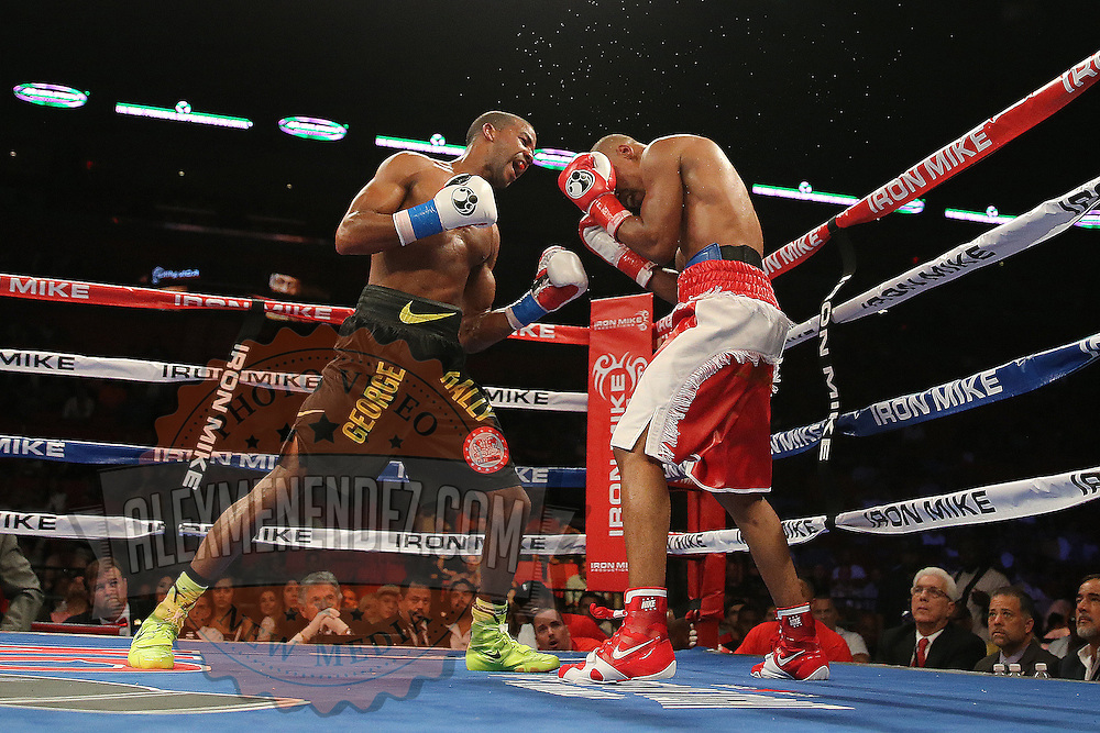 """IBF Junior Lightweight Champion Argenis """"La Tormenta"""" Mendez (red trunks) fights against number one contender Rances """"Kid Blast"""" Barthelemy  during the """"Judgement Day"""" boxing event at American Airlines Arena on Thursday, July 10, 2014 in Miami, Florida.  Barthelemy won the fight after 12 rounds. (AP Photo/Alex Menendez)"""