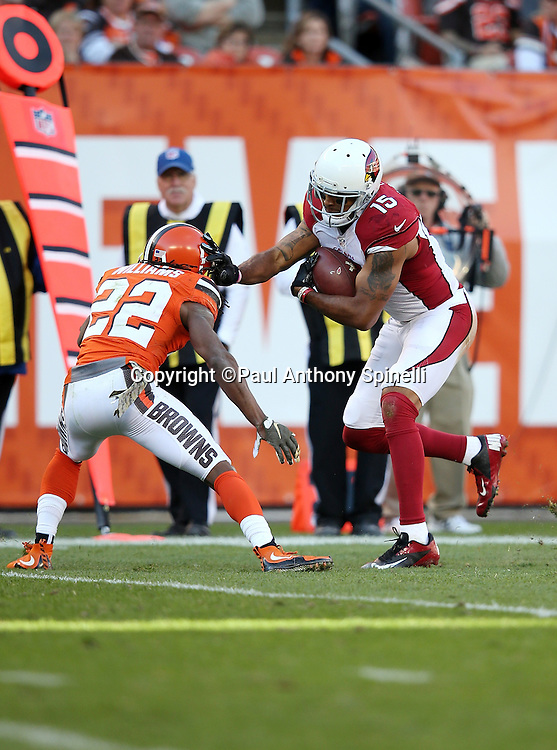 Arizona Cardinals wide receiver Michael Floyd (15) straight arms Cleveland Browns cornerback Tramon Williams (22) as he runs with the ball after catching a pass during the 2015 week 8 regular season NFL football game against the Cleveland Browns on Sunday, Nov. 1, 2015 in Cleveland. The Cardinals won the game 34-20. (©Paul Anthony Spinelli)