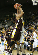 25 JANUARY 2007:  Minnesota forward/center Ashley Ellis-Milan (21) puts a shot up in front of Iowa center Megan Skouby (44) in Iowa's 80-78 overtime loss to Minnesota at Carver-Hawkeye Arena in Iowa City, Iowa on January 25, 2007.