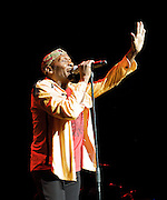 Jimmy Cliff <br /> Live in concert at Indigo 2, 02 Arena, London, Great Britain <br /> May 18th 2012 <br /> <br /> Photograph by Elliott Franks <br /> <br /> Jimmy Cliff, OM (born James Chambers on 1 April 1948) is a Jamaican musician, singer and actor. He is the only currently living musician to hold the Order of Merit, the highest honour that can be granted by the Jamaican government for achievement in the arts and sciences.<br /> Cliff is best known among mainstream audiences for songs such as &quot;Sitting in Limbo&quot;, &quot;You Can Get It If You Really Want&quot; and &quot;Many Rivers to Cross&quot; from the soundtrack to The Harder They Come, which helped popularize reggae across the world and his covers of Cat Stevens' &quot;Wild World&quot; and Johnny Nash's &quot;I Can See Clearly Now&quot; from the film Cool Runnings. Outside of the reggae world, he is probably best known for his film appearance in The Harder They Come. Cliff was one of five performers inducted into the Rock and Roll Hall of Fame in 2010.