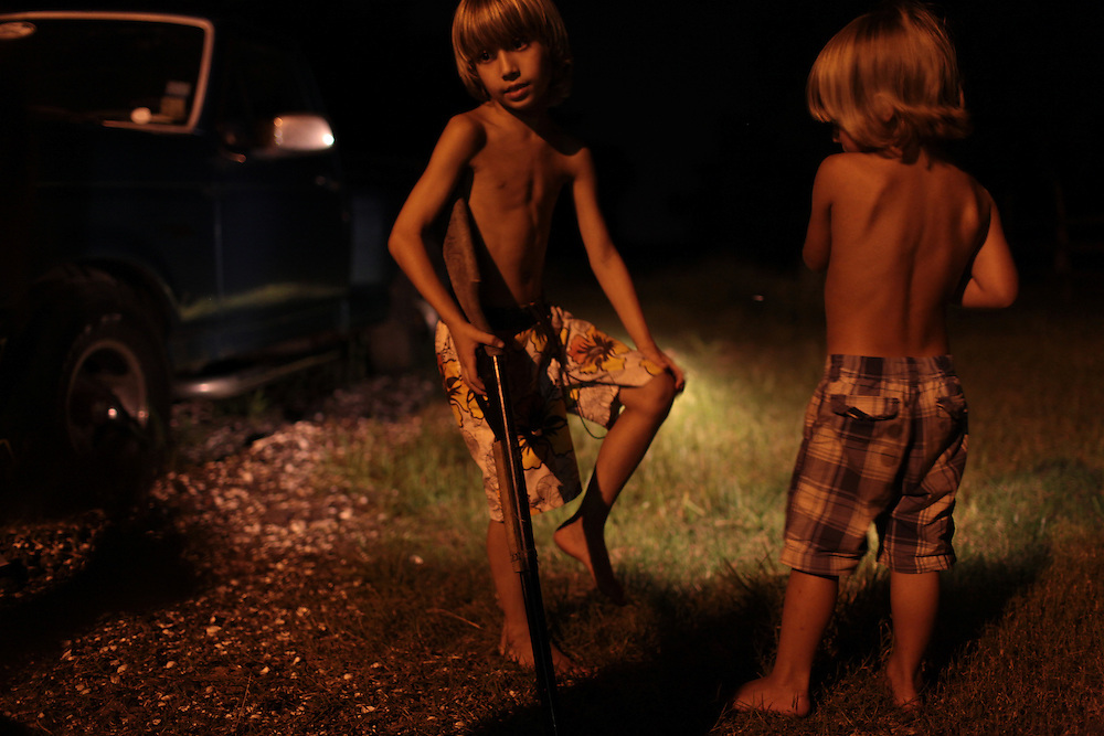 Morgan Serigne, 6, and his brother Logan Serigne, 4, play outside their home in Poydras, LA on July  12th, 2010.