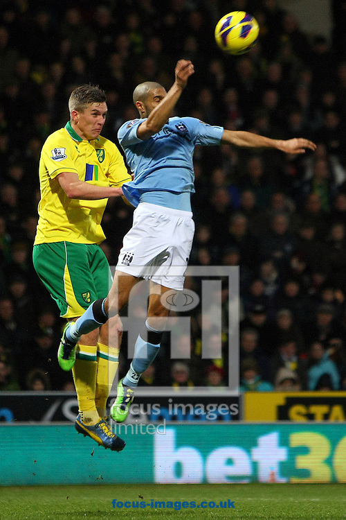 Picture by Paul Chesterton/Focus Images Ltd +44 7904 640267.29/12/2012.Steve Morison of Norwich and Gaël Clichy of Man City in action during the Barclays Premier League match at Carrow Road, Norwich.