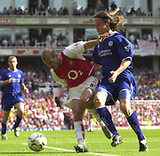 Premiership Football - Arsenal v Leicester City:.2003/04 Season - 15/05/2004  [Record breaking Season undefeated] .Fredrik Ljungberg, tries to go round  Lilian Nalis.[Credit] Peter Spurrier Intersport Images