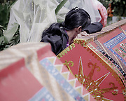 Merlin Karaeng (26) cries at the sight of her mother's coffin, Martha Limbong, who died in 2015 at age 72. Merlin misses her mother and she is happy to see her<br /> <br /> Ma'nene is a tradition that takes place in August after harvest where the bodies of the dead loved ones are exhumed to be cleaned, groomed and dressed. For most, it's a bittersweet moment, a chance to reunite and physically see and touch and reconnect with loved ones who had passed on.