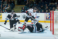 KELOWNA, CANADA - OCTOBER 24: Beck Malenstyn #11 of Calgary Hitmen tries to score a goal on Jackson Whistle #1 of Kelowna Rockets on October 24, 2015 at Prospera Place in Kelowna, British Columbia, Canada.  (Photo by Marissa Baecker/Shoot the Breeze)  *** Local Caption *** Jackson Whistle; Beck Malenstyn;