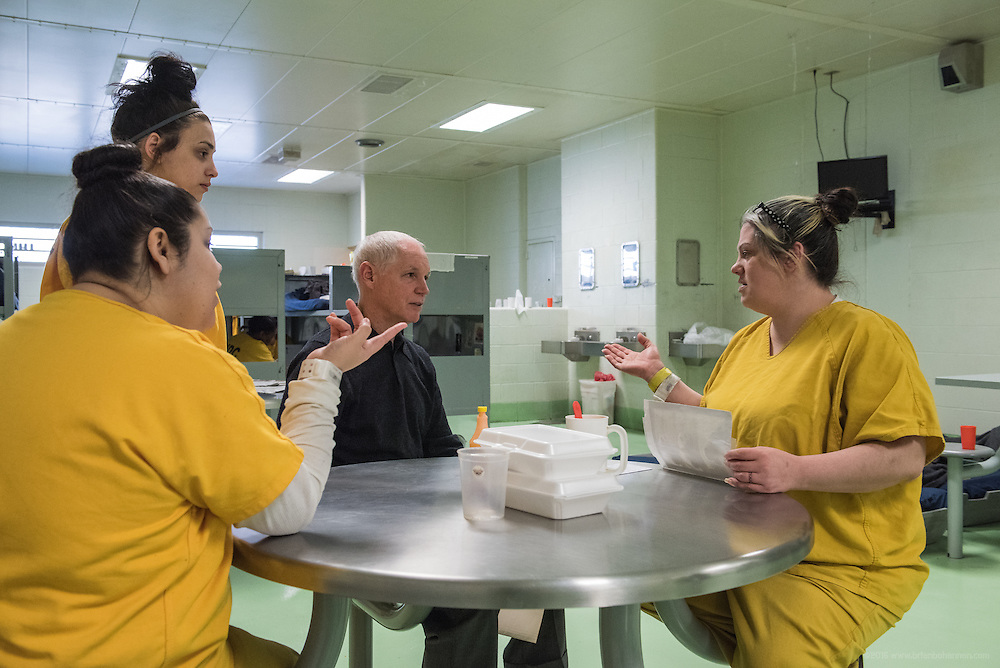 Inmates Emily Childs and Fatima Aduabudiab, left, and Keslie Bailey, right, talk with Steve Durham, assistant director of Louisville Metro Corrections. (Photo by Brian Bohannon)