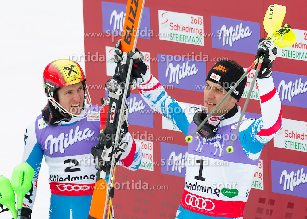 17.02.2013, Planai, Schladming, AUT, FIS Weltmeisterschaften Ski Alpin, Slalom, Herren, 2. Durchgang, im Bild Marcel Hirscher (AUT, 1. platz), Mario Matt (AUT, 3. Platz) // 1st place Marcel Hirscher of Austria and 2nd place Mario Matt of Austria reacts after his 2nd run of the mens Slalom at the FIS Ski World Championships 2013 at the Planai Course, Schladming, Austria on 2013/02/17. EXPA Pictures © 2013, PhotoCredit: EXPA/ Johann Groder