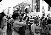 A couple kissing amidst the crowd, Notting Hill Carnival, London, 1989