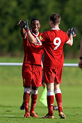 BLACKBURN, ENGLAND - Saturday, January 6, 2018: Liverpool's Rafael Camacho celebrates with team-mate Liam Millar after scoring the fifth goal, to complete his hat-trick, during an Under-18 FA Premier League match between Blackburn Rovers FC and Liverpool FC at Brockhall Village Training Ground. (Pic by David Rawcliffe/Propaganda)