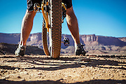 SHOT 10/16/16 3:45:26 PM - Taking in the view along the White Rim Trail. The White Rim is a mountain biking trip in Canyonlands National Park just outside of Moab, Utah. The White Rim Road is a 71.2-mile-long unpaved four-wheel drive road that traverses the top of the White Rim Sandstone formation below the Island in the Sky mesa of Canyonlands National Park in southern Utah in the United States. The road was constructed in the 1950s by the Atomic Energy Commission to provide access for individual prospectors intent on mining uranium deposits for use in nuclear weapons production during the Cold War. Four-wheel drive vehicles and mountain bikes are the most common modes of transport though horseback riding and hiking are also permitted.<br /> (Photo by Marc Piscotty / &copy; 2016)