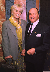 MR ARNOLD CROOK of the Theatre Royal Haymarket  and his wife JEANNE MANDRY, at a reception in London on 3rd February 1998.MFB 8
