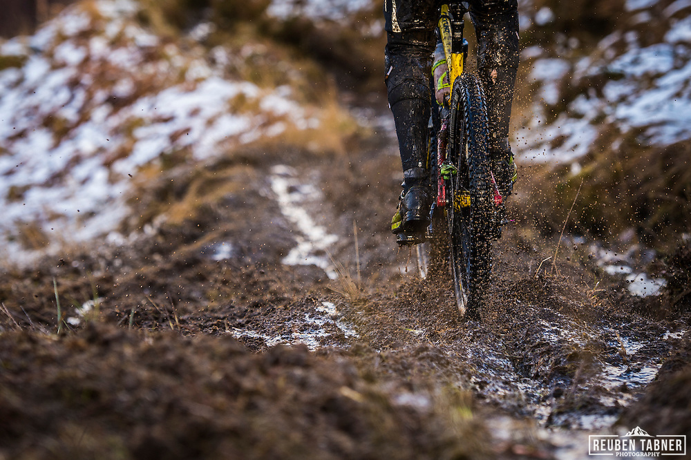 Did we say it was muddy? Riders don't have chance to keep clean as snow turns to mud on stage one of the Kinlochleven Enduro. (Rider: Alexander Roger)