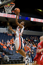 Virginia guard Monica Wright (22) shoots a layup against Davidson.  The Virginia Cavaliers women's basketball team defeated the Davidson Wildcats 83-68 at the John Paul Jones Arena in Charlottesville, VA on December 20, 2007.