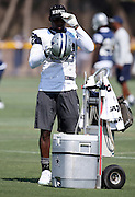 Dallas Cowboys wide receiver Dez Bryant (88) puts on his helmet after taking a drink break during the second day of the Dallas Cowboys 2016 NFL training camp football practice held on Sunday, July 31, 2016 in Oxnard, Calif. (©Paul Anthony Spinelli)