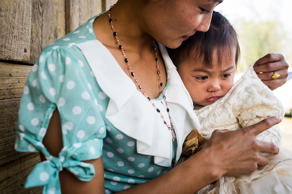 A young mother and daughter at the JE vaccination campaign in Khon Kahndone Village, Xieng Khouang province, Laos.