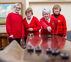 A Summer Ice Table will be included in the Bonham's Scottish Sale on April 25-26th 2018. Members of the Queich Curling Club with the polished mahogany table and steel stones.<br /> <br /> Team members are Tish Alderson (skip), Anne Hepburn (third), Cath Ballantyne (second) and Claire Stevens (lead)