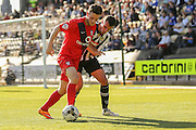York City forward Reece Thompson shields the ball from Notts County defender Haydn Hollis during the Sky Bet League 2 match between Notts County and York City at Meadow Lane, Nottingham, England on 26 September 2015. Photo by Simon Davies.
