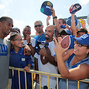 Victor Cruz posing for photographs with fans after training during the 2013 New York Giants Training Camp at the Quest Diagnostics Training Centre, East Rutherford, New Jersey, USA. 29th July 2013. Photo Tim Clayton. .