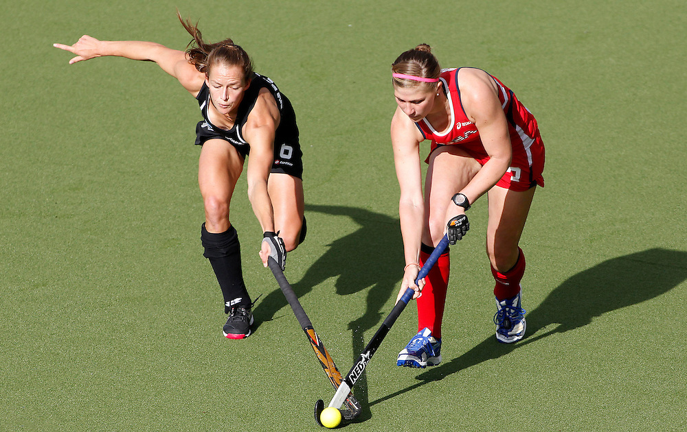 New Zealand's Petrea Webster and USA's Katelyn Falgowski clash in their four nations hockey match at Lloyd Elsmore Hockey Stadium, Auckland, New Zealand, Thursday, April 19, 2012. Credit:SNPA / Ben Campbell..