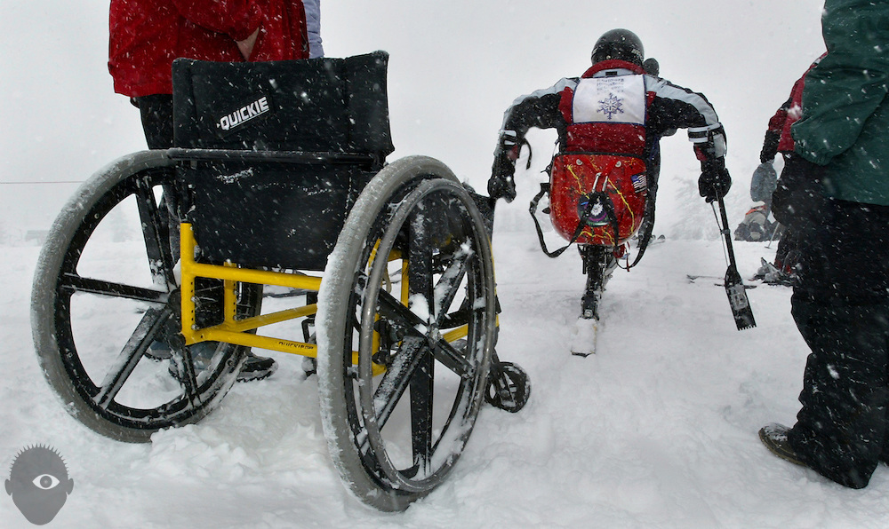 Sarah McKinley, 18, of Vancouver, leaves her chair behind as she heads for the slopes in her  mono ski. The Shriner Hospital's Ski and Snowboard program pairs volunteers with disabled kids at Timberline on Mt. Hood..