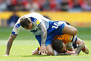 YELLOW CARD / RED CARD Newport County defender Mark O'Brien (25) fouls Tranmere Rovers striker James Norwood (10) during the EFL Sky Bet League 2 Play Off Final match between Newport County and Tranmere Rovers at Wembley Stadium, London, England on 25 May 2019.