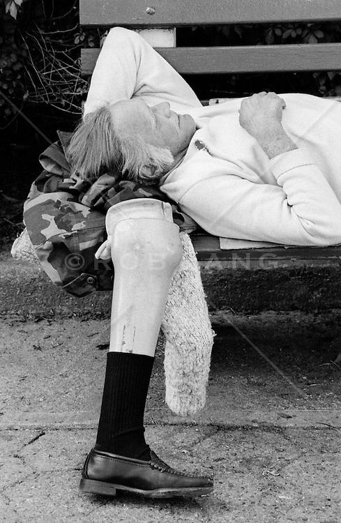 Prosthetic leg next to sleeping homeless man