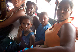 30 August, 2005. New Orleans Louisiana. Hurricane Katrina aftermath. <br /> Evacuees cram into an army truck as they are evacuated from the lower 9th ward. 9yr old Brionne Williams is surrounded by her family. Hundreds of desperate evacuees from the lower 9th ward await transportation to the Superdome where approximately 20,000 storm evacuees are housed.<br /> Photo Credit: Charlie Varley/varleypix.com