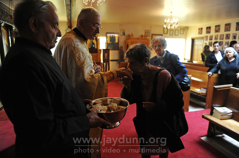 Parishioners receive blessings from Father Mark Vinas, 84, at St. John the Baptist Greek Orthodox Church in Salinas.