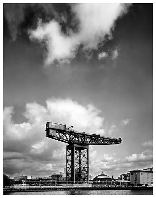 Black and white photograph of The Finnieston Crane on the River Clyde in Glasgow. Mounted print available to purchase.