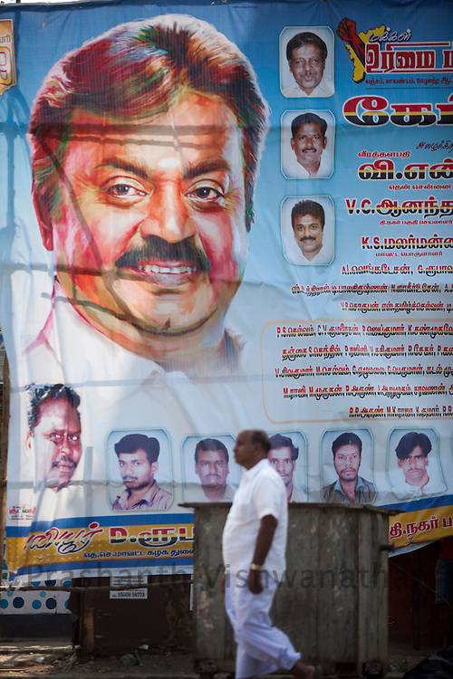A man walks past an election poster of Vijaykanth an famous actor turned into politician in Chennai, India, on Saturday  January 15, 2011. Vijaykanth formed the center-left winged Desiya Murpokku Dravida Kazhagam (DMDK), a regional political party in Tamil Nadu. He formally announced party formation on 14 September 2005 at Madurai. He is a veteran of more than 150 movies. He is known as 'Captain' to his fans and collegues in Kollywood. Vijayakanth was awarded the Honorary Doctorate in December 2010 for his services to the poor.  Photographer: Prashanth Vishwanathan/HELSINGIN SANOMAT