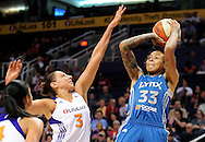 Sep 11, 2011; Phoenix, AZ, USA; Minnesota Lynx guard Seimone Augustus (33) puts up a shot against Phoenix Mercury guard Diana Taurasi (3) at the US Airways Center.  The Lynx defeated the Mercury 96-90. Mandatory Credit: Jennifer Stewart-US PRESSWIRE
