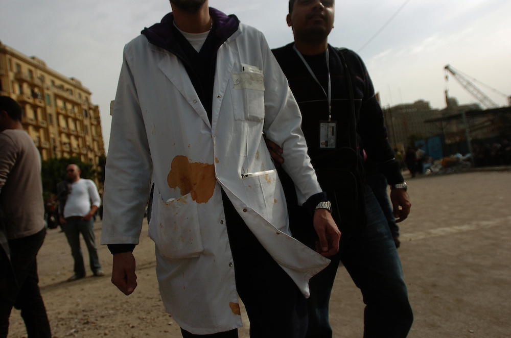 Volunteer Doctors help the injured people after clashes between pro and anti Mubarak protestors