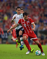 MUNICH, GERMANY - Tuesday, August 1, 2017: Liverpool's Roberto Firmino and FC Bayern Munich's Mats Hummels during the Audi Cup 2017 match between FC Bayern Munich and Liverpool FC at the Allianz Arena. (Pic by David Rawcliffe/Propaganda)