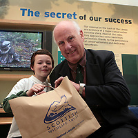 20.6.2006. (FREE SINGLE USE PICTURE)<br /> Scottish Wildlife Trust, chick naming competition winner, 8 year old George Hughs (correct), receiving his prize goody bag from SWT chairman Dennis Dicks at the SWT Loch of the Lowes Wildlife reserve visitor centre.<br /> For naming the recently hatched Osprey chicks Tay and Tummel after Perthshire Lochs George won a VIP trip to the Reserve for him and his classmates from Dunbarney Primary Scool, Bridge of Earn. <br /> <br /> Please see SWT Press Release or for more info telKirsty Leiper 0131 225 4646 / 07711 227146 or Clara Govier 0131 312 4747 / 07795 241088<br /> <br /> <br /> Picture by John Lindsay<br /> COPYRIGHT: Perthshire Picture Agency.<br /> Tel. 01738 623350 / 07775 852112.