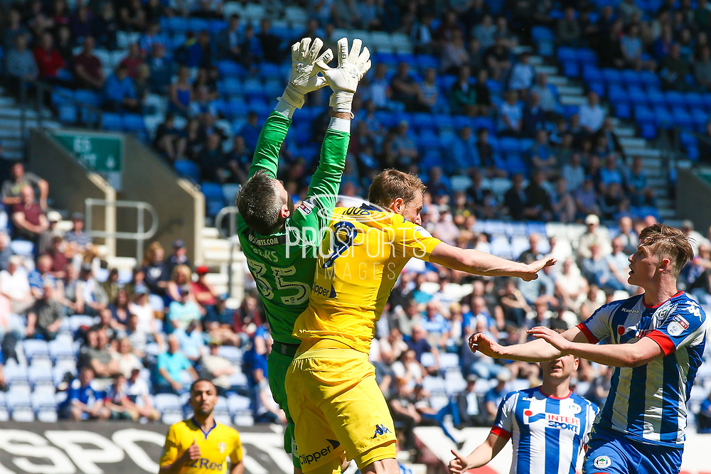 Wigan Athletic  goalkeeper Matthew Gilks (35)  is challenged by Leeds United forward Chris Wood (9)  during the EFL Sky Bet Championship match between Wigan Athletic and Leeds United at the DW Stadium, Wigan, England on 7 May 2017. Photo by Simon Davies.