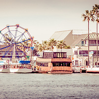 Panorama photo of the Newport Beach Fun Zone from Newport Harbor. Panorama photo ratio is 1:3 and has a vintage retro 1970s tone. Picture includes the Ferris Wheel, Tiki Boat, Balboa Car Ferry, and other popular attractions on Balboa Peninsula. Newport Beach is an affluent beach city in Orange County Southern California.