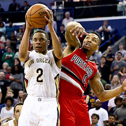 Mar 18, 2016; New Orleans, LA, USA; New Orleans Pelicans guard Tim Frazier (2) shoots over Portland Trail Blazers guard Damian Lillard (0) during the fourth quarter of a game at the Smoothie King Center. The Trail Blazers defeated the Pelicans 117-112.  Mandatory Credit: Derick E. Hingle-USA TODAY Sports