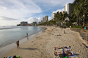 Waikiki Beach. Fat tourists sunbathing.
