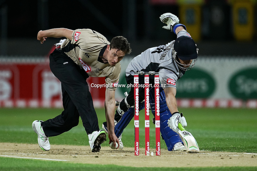 North Island's Adam Milne (L) attempts to run out South Island's Nathan McCullum during the Island of Origin T20 cricket game - North v South, 31 October 2014 played at Seddon Park, Hamilton, New Zealand on Friday 31 October 2014.  Photo: Bruce Lim / www.photosport.co.nz