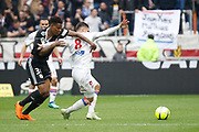 Houssem Aouar of Lyon and Zungu Bongani of Amiens during the French championship L1 football match between Olympique Lyonnais and Amiens, on April 14, 2018 at Groupama stadium in Decines Charpieu near Lyon, France - Photo Romain Biard / Isports / ProSportsImages / DPPI