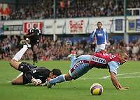 Photo: Lee Earle.<br /> Portsmouth v Aston Villa. The Barclays Premiership. 02/12/2006. Portsmouth keeper David James (L) brings down Gabriel Agbonlahor for a penalty.