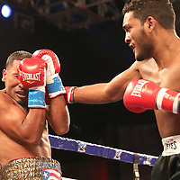 Gerald Semidy gets punched in the head by Yasmani Pedroso during a Telemundo boxing match at Osceola Heritage Park on Friday, July 20, 2018 in Kissimmee, Florida.  (Alex Menendez via AP)