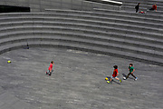 Young boys play football during the UK's Conoriavirus pandemic lockdown, on 7th June 2020, in London, England.