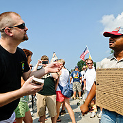 "Disagreement between pro- and anti- rally attendees. Conservative television commentator Glenn Beck's ""Restore Honor"" conservative rally at the Lincoln Memorial on the National Mall, held on the 47th anniversary of Dr. Martin Luther King's famous ""I Have a Dream"" civil rights speach of 1963. Speakers from the stage erected on the lower steps of the Lincoln Memorial included Beck himself along with former vice presidential candidate Sarah Palin."