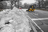 Still cleaning up piles of snow in Central Park after winter storm Stella.