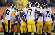 The Pittsburgh Steelers offense huddles and calls a play during the NFL AFC Wild Card playoff football game against the Cincinnati Bengals on Saturday, Jan. 9, 2016 in Cincinnati. The Steelers won the game 18-16. (©Paul Anthony Spinelli)