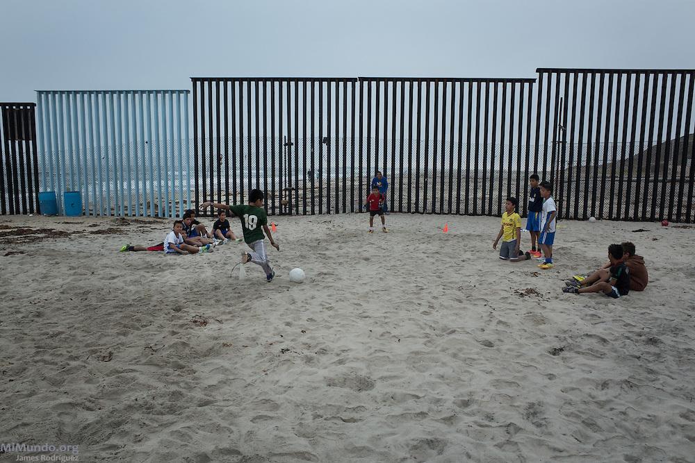 Children play soccer near the Mexico-US border. Tijuana, Baja California, Mexico. May 30, 2015.