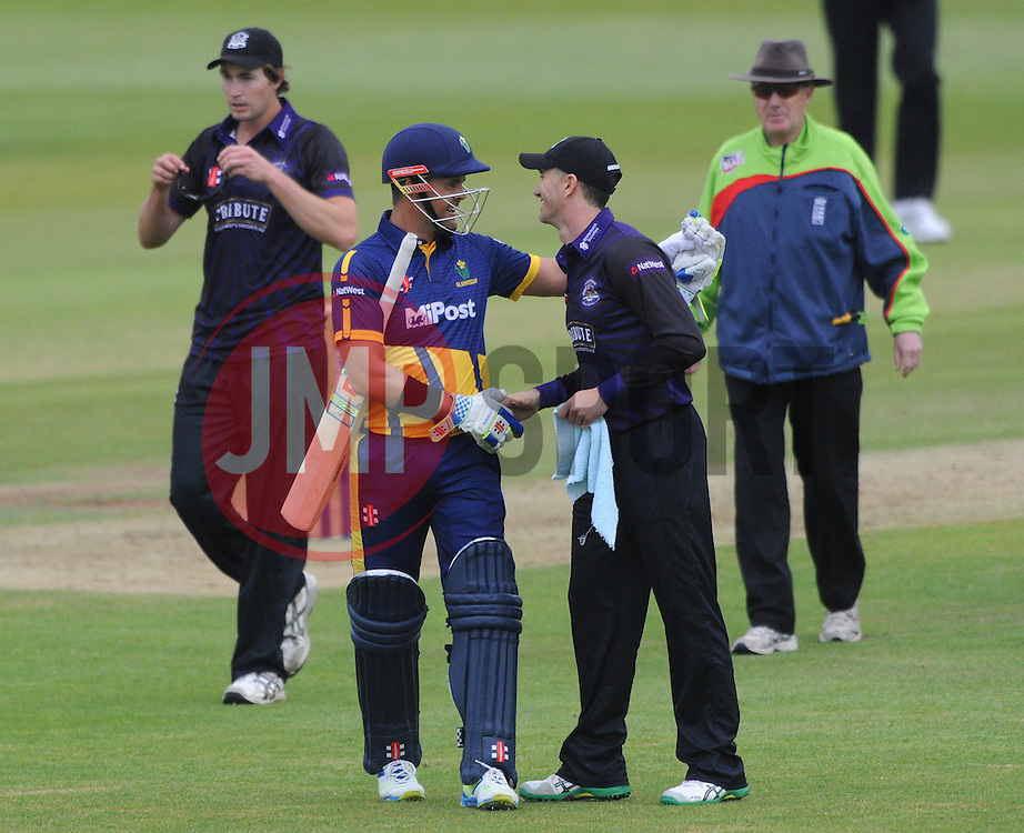 Michael Klinger of Gloucestershire congratulates Jacques Rudolph of Glamorgan on scoring a century - Photo mandatory by-line: Dougie Allward/JMP - Mobile: 07966 386802 - 12/06/2015 - SPORT - Cricket - Bristol - County Ground - Gloucestershire v Glamorgan - Natwest T20 Blast