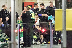 © Licensed to London News Pictures. 23/05/2017. Manchester, UK. Police and other emergency services tending to injured people on the platform at Victoria Station near the Manchester Arena after reports of an explosion. Police have confirmed they are responding to an incident during an Ariana Grande concert at the venue. Photo credit: Joel Goodman/LNP