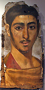 Portrait painted in encaustic on wooden panels, once fitted over the faces of mummified corpses. A young man, perhaps a soldier, wearing a cloak fastened with a gold brooch, about AD 193-235
